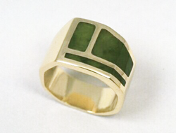 Ring inlaid with green Nephrite Jade.