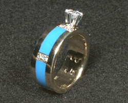 Engagement ring inlaid with several pieces of plain blue Sleeping Beauty Turquoise on the sides.