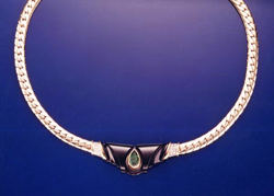 Necklace with carved Black Jade and a pear shaped Emerald in the middle.