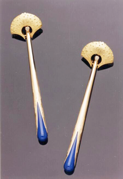 Long gold earrings with Lapis coming out of the bottom.