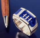 Small photo of a Lapis ring with invisible set Diamonds and gold rods.