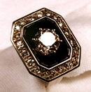 Small photo of a ring with Black Jade around a center diamond.