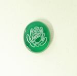 Photo of an oval green Onyx stone with the image of a flower which was made with a laser.