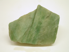 Picture of a rough green rock called aventurine.
