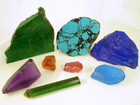 Picture of misc. rough gemstone materials of various colors.