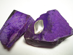 Several pieces of Sugilite rough material