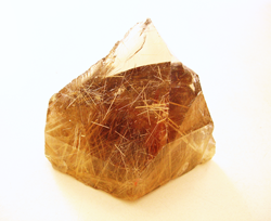 Shows a 4 inch tall large crystal of Rutillated Quartz.