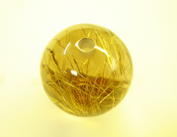 Photo showing the hold in the bottom of the Rutillated Quartz sphere.