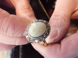 Shows the jeweler holding the finished ring.