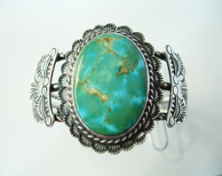 Turquoise cabochon which has been repaired.