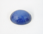 Photo of a Linde Star Sapphire cabochon which needs to be re-polished.
