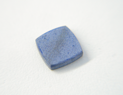 Photo of a square flat Lapis cabochon which has a whiteish surface because it was etched by acid.