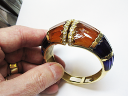 Photo of a bracelet with a broken synthetic Citrine carving.