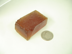 Photo of a block of synthetic Citrine rough material.