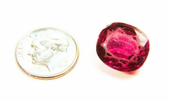 A Rhodolite gemstone that is all scratched.