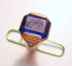 An emerald cut Tanzanite mounted in a ring.