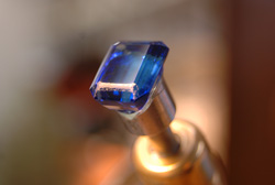The emerald cut Tanzanite mounted in my faceting machine.