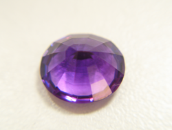 Shows the finished oval Amethyst which has been repaired.