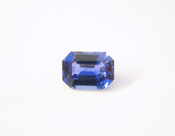 A top view of the finished emerald cut blue Sapphire which has been repaired.