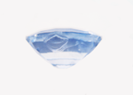Photo of a light blue Sapphire with a large chip in the side of the pavilion.