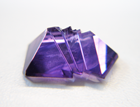 Photo of a purple Amethyst fantasy cut which is chipped and needs to be repaired.
