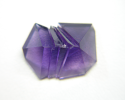 Another view of the bottom of the fantasy cut Amethyst showing the chip which needs to be repaired.
