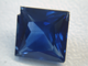 Small photo of a facetedSapphire with a chip.