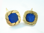 Photo of a pair of cufflinks with Lapis inlays. The one on the right is broken.