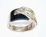 Photo of a ring with an eagle which needed the Onyx inlay repaired.