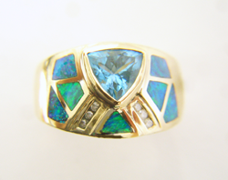 Photo of the finished ring with new Opal inlays which match.