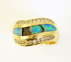 Photo of a 14 karat gold ring with 2 broken Opal inlays.