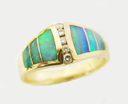 Photo of the finished ring with 3 new Opal inlays wich match the other 3 inlays in the ring.