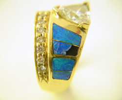 Opal inlay ring with a Trillion diamond with a broken inlay.