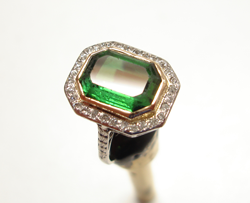 Shows ring with the green Tourmaline. The table has been re-polished.