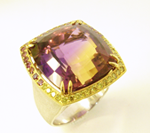 Photo of an Ametrine gemstone in the ring.