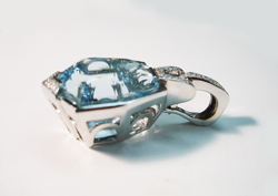 Photo of the white gold pendant with a Blue Topaz set in it.