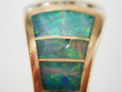 Photo of an Opal inlay wiht scratches and a chip