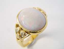 A ring with an Opal cab which is very scratched and dull.