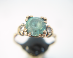 Photo of a ring with a Zircon which has a table and star facets which are very scratched and worn and need to be re-polished.