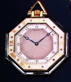 Finished pocketwatch with the movment mounted into the octagonal carved Quartz watch case.