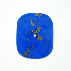 A rectangular Lapis watch dial which has rounded corners.